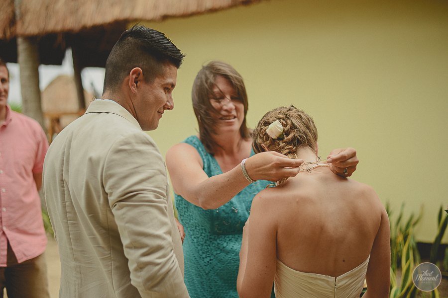 mother of the groom puts a necklace